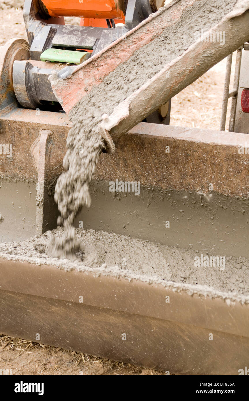 wet concrete being pored from cement lorry truck building industry construction delivery slump test aggregate water - Stock Image