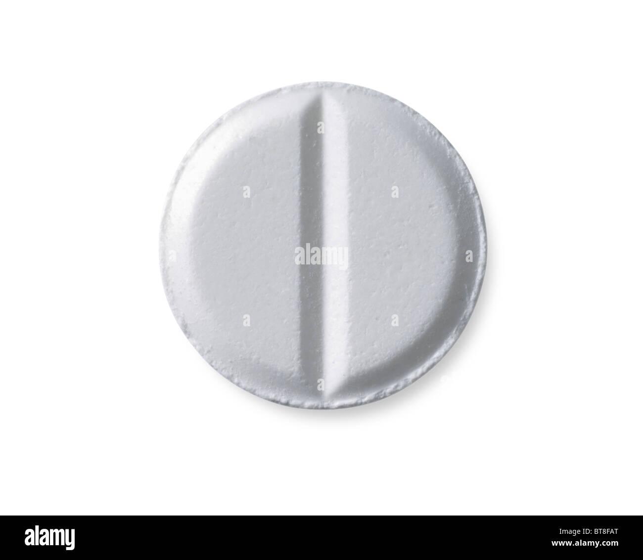 White circular medicinal pill. - Stock Image