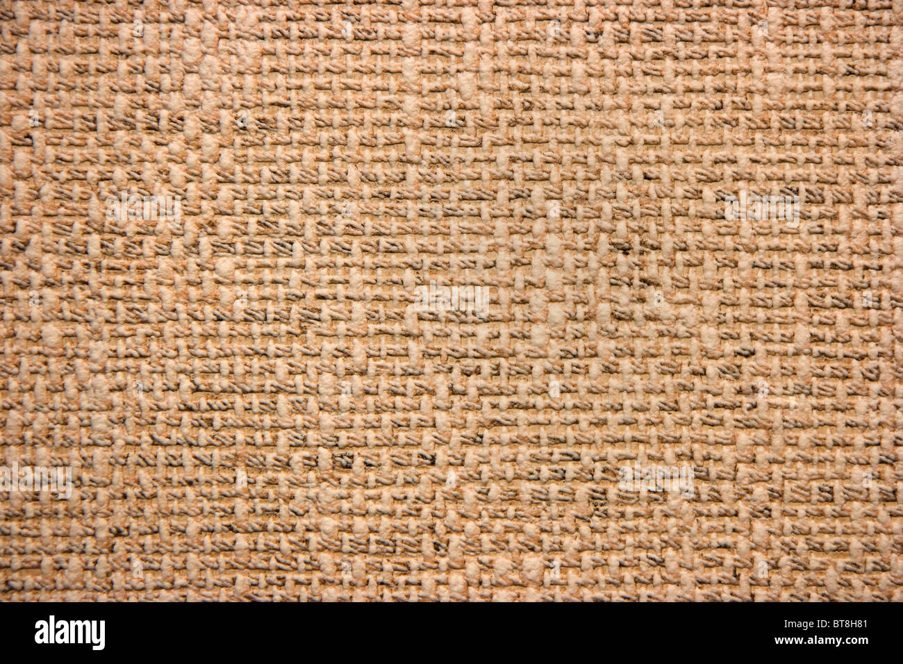 Photo of a structure of wall-paper in yellowy-brown tones - Stock Image