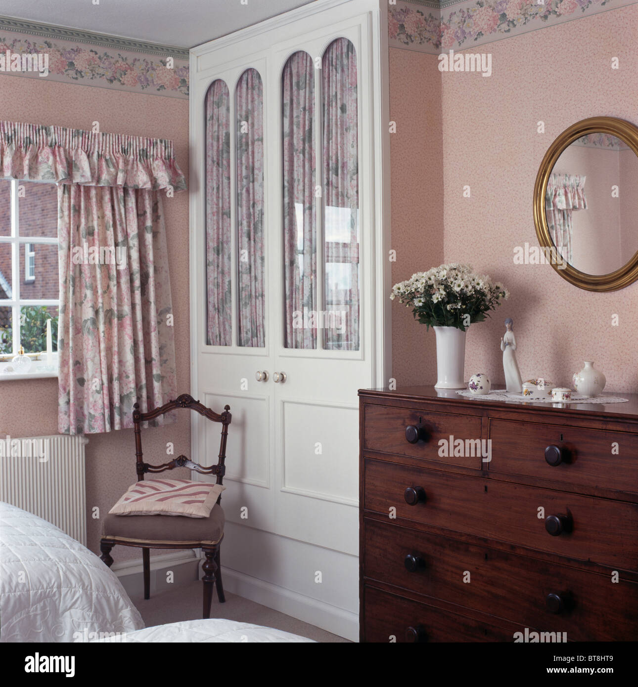 Fitted wardrobe with curtains behind glazed doors in cottage bedroom with pink wallpaper and curtains & Fitted wardrobe with curtains behind glazed doors in cottage bedroom ...