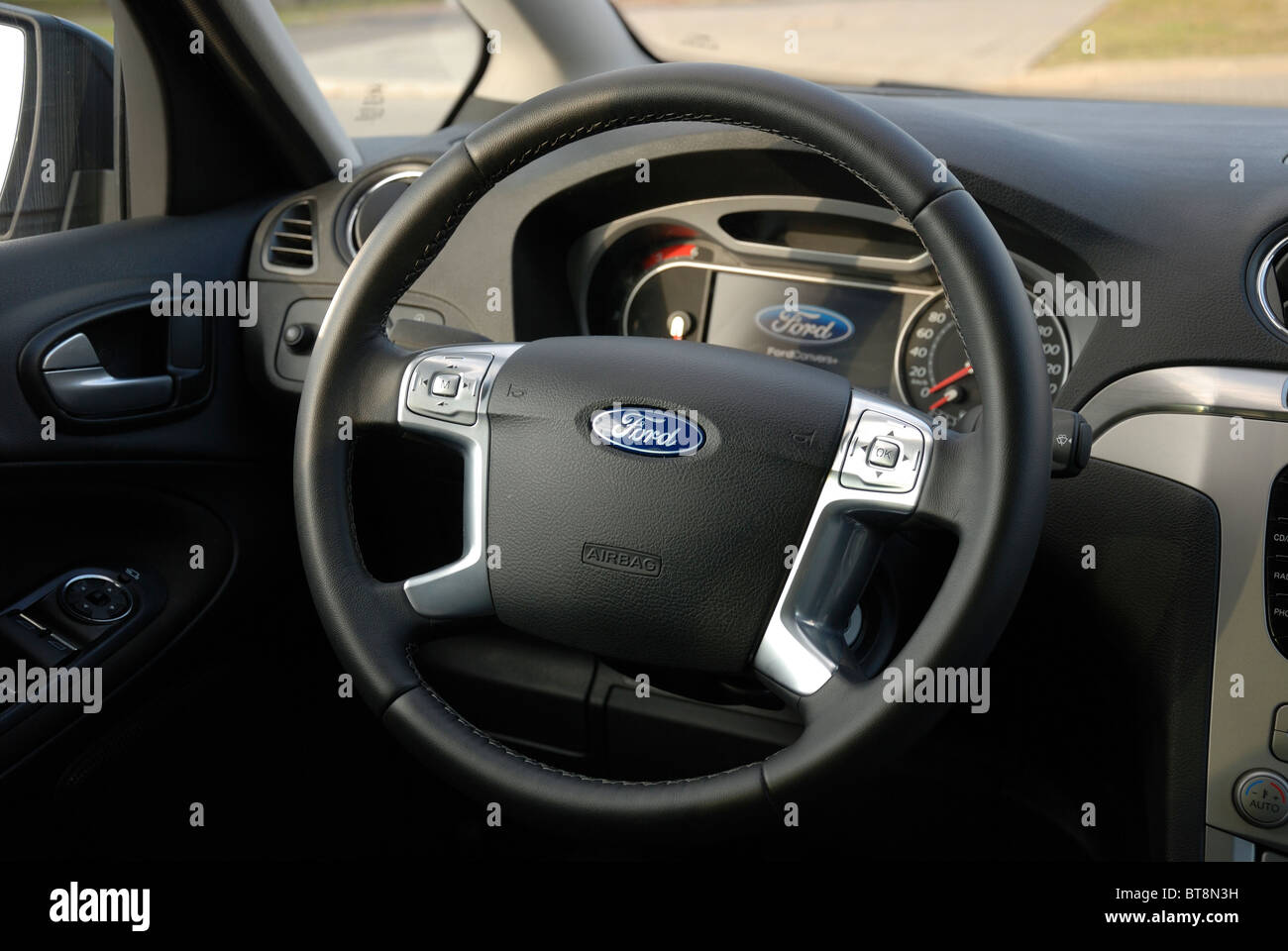 Ford S-MAX 2.0 TDCI - 2006 - black metallic - five doors (5D) - Popular German MPV (minivan) - interior, steering - Stock Image
