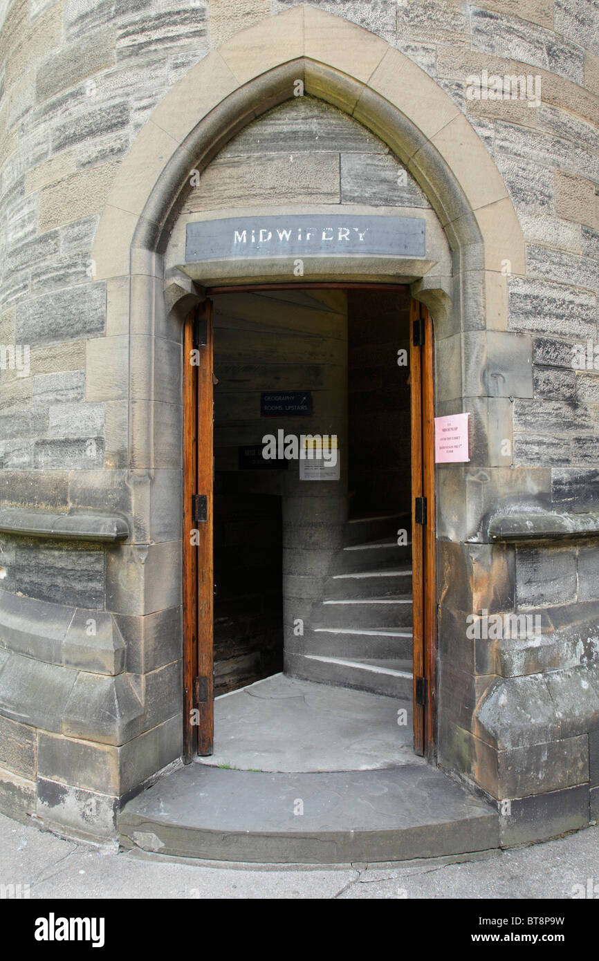 Entrance to a turret with a Midwifery sign on the East Quadrangle at the University of Glasgow Gilmorehill Campus, - Stock Image
