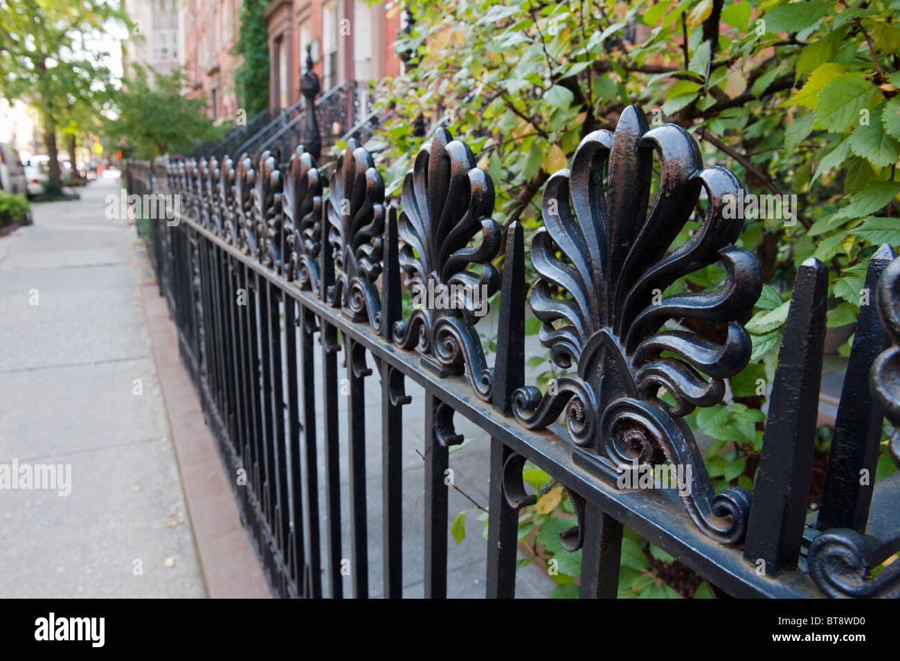 Detail of ornate iron railings on street in Chelsea district of Manhattan New York City - Stock Image