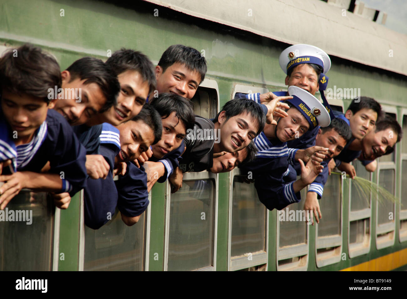 Vietnamese sailors in a train, Central Vietnam, Asia - Stock Image