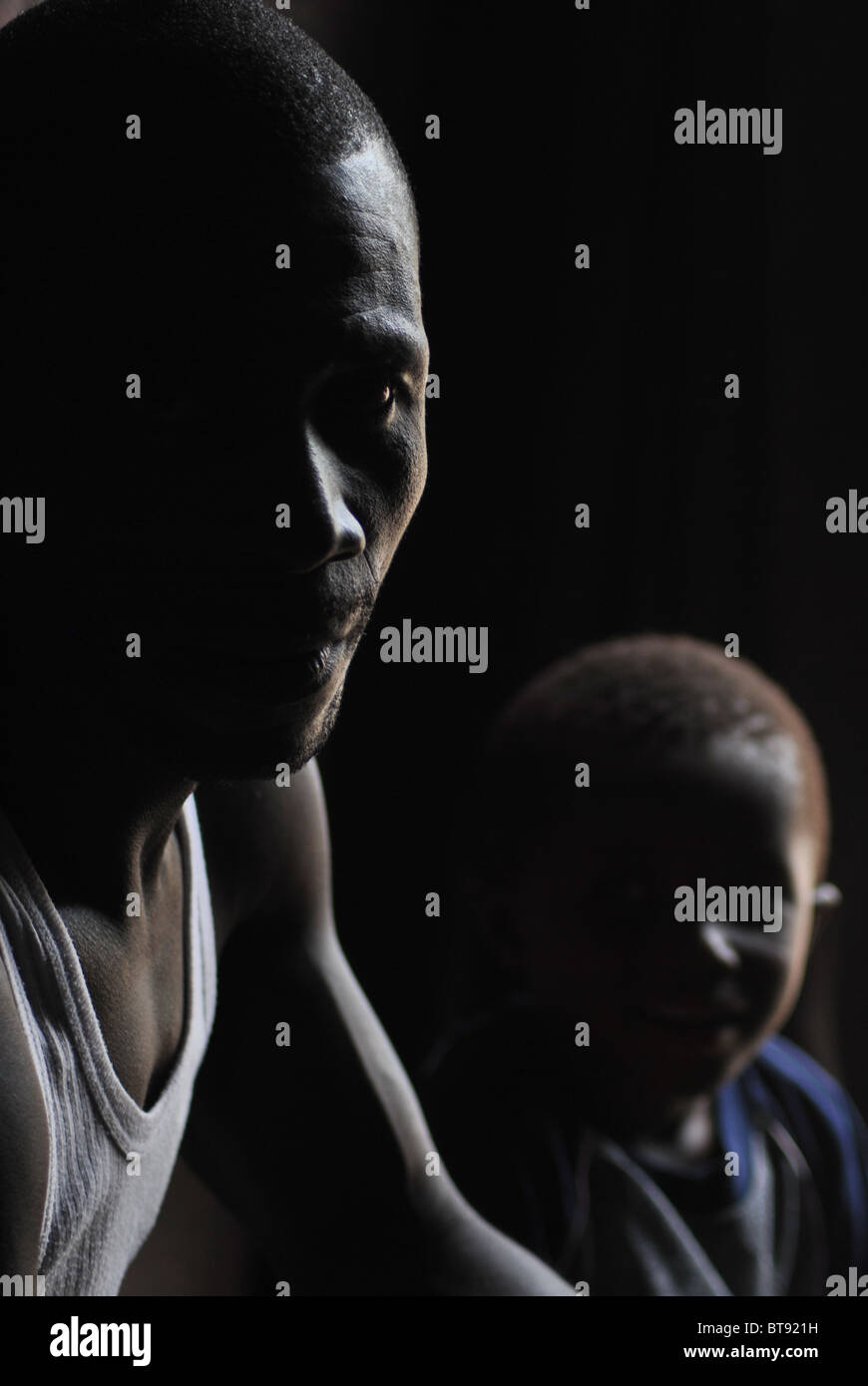 Liberian refugees inside their makeshift shelter in Tabou Transit Camp, Ivory Coast, West Africa - Stock Image