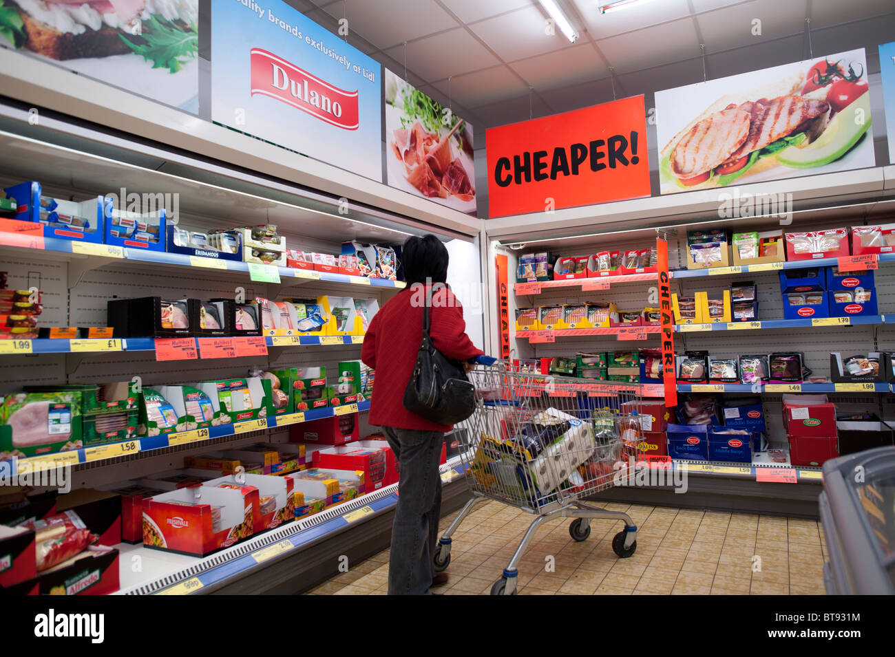 A woman shopping for bargain foods in Lidl discount supermarket UK - Stock Image