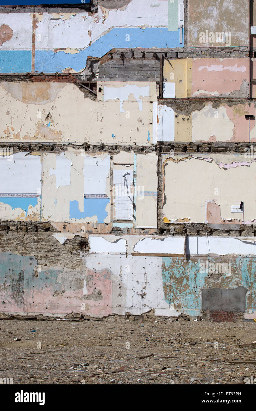 Partially Demolished House with Bathroom Shower attachment remaining - Stock Image