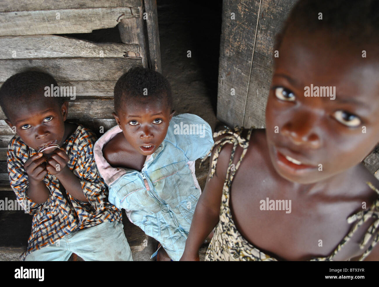 Scared Liberian refugee children in Tabou Transit Camp, West Africa - Stock Image
