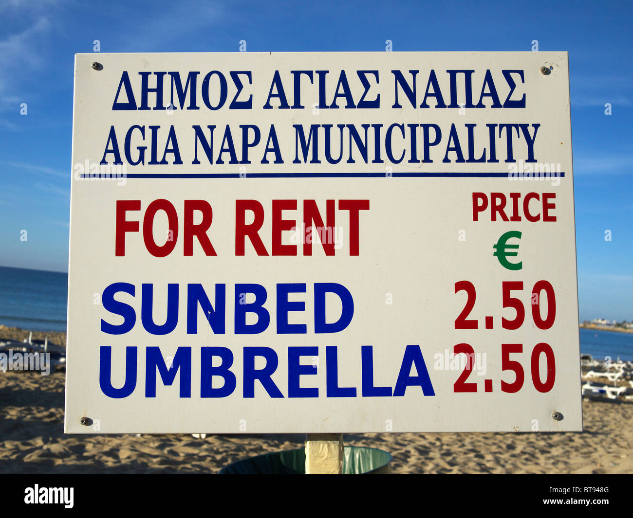 Sunbed and umbrella rent sign Ayia Napa Cyprus - Stock Image