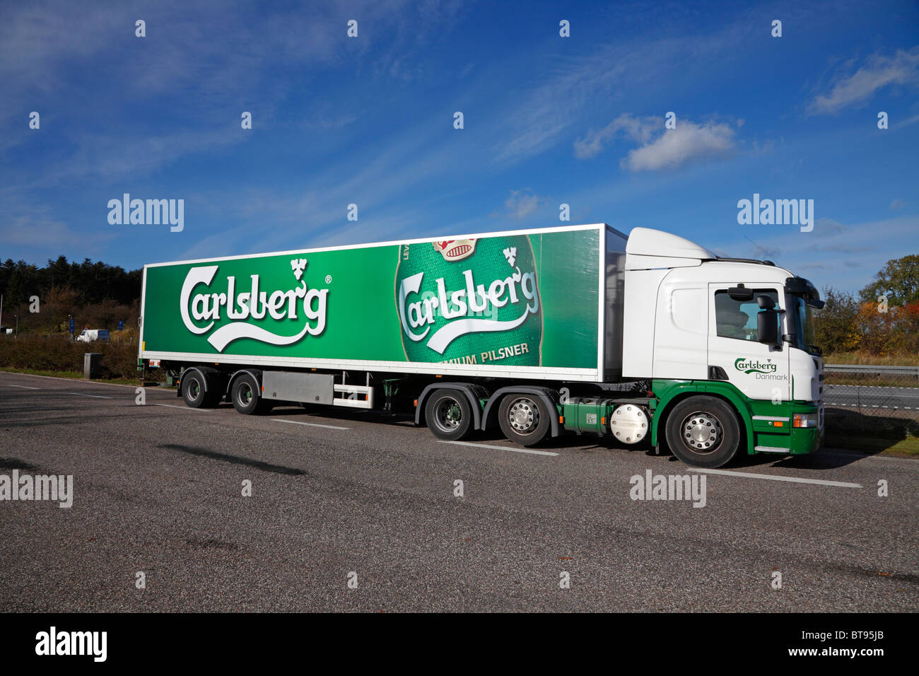 Truck from the Carlsberg Breweries transporting beer on a Danish freeway - Stock Image