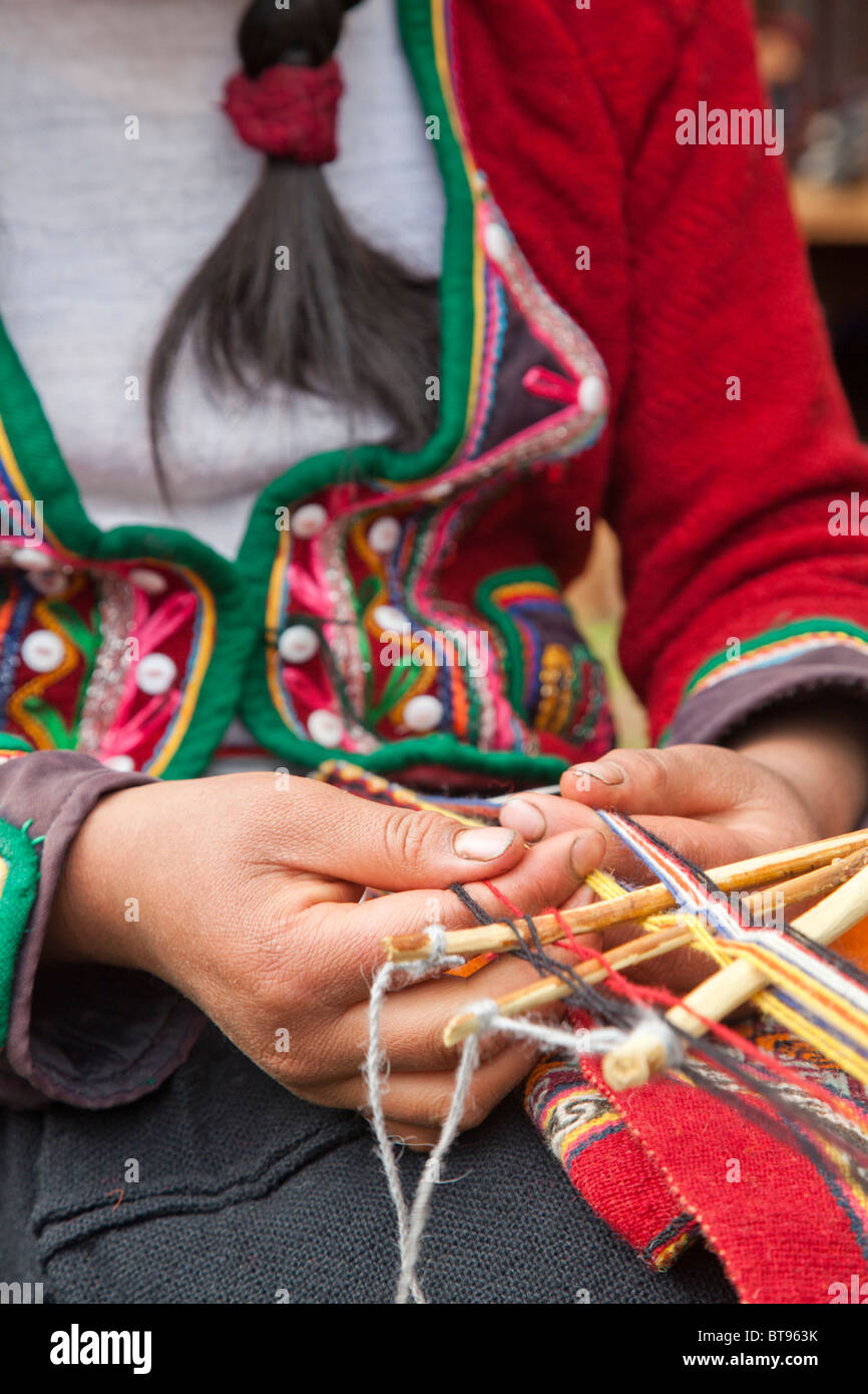 Quechua woman works a loom used to make textiles, Cusco Peru, South America - Stock Image