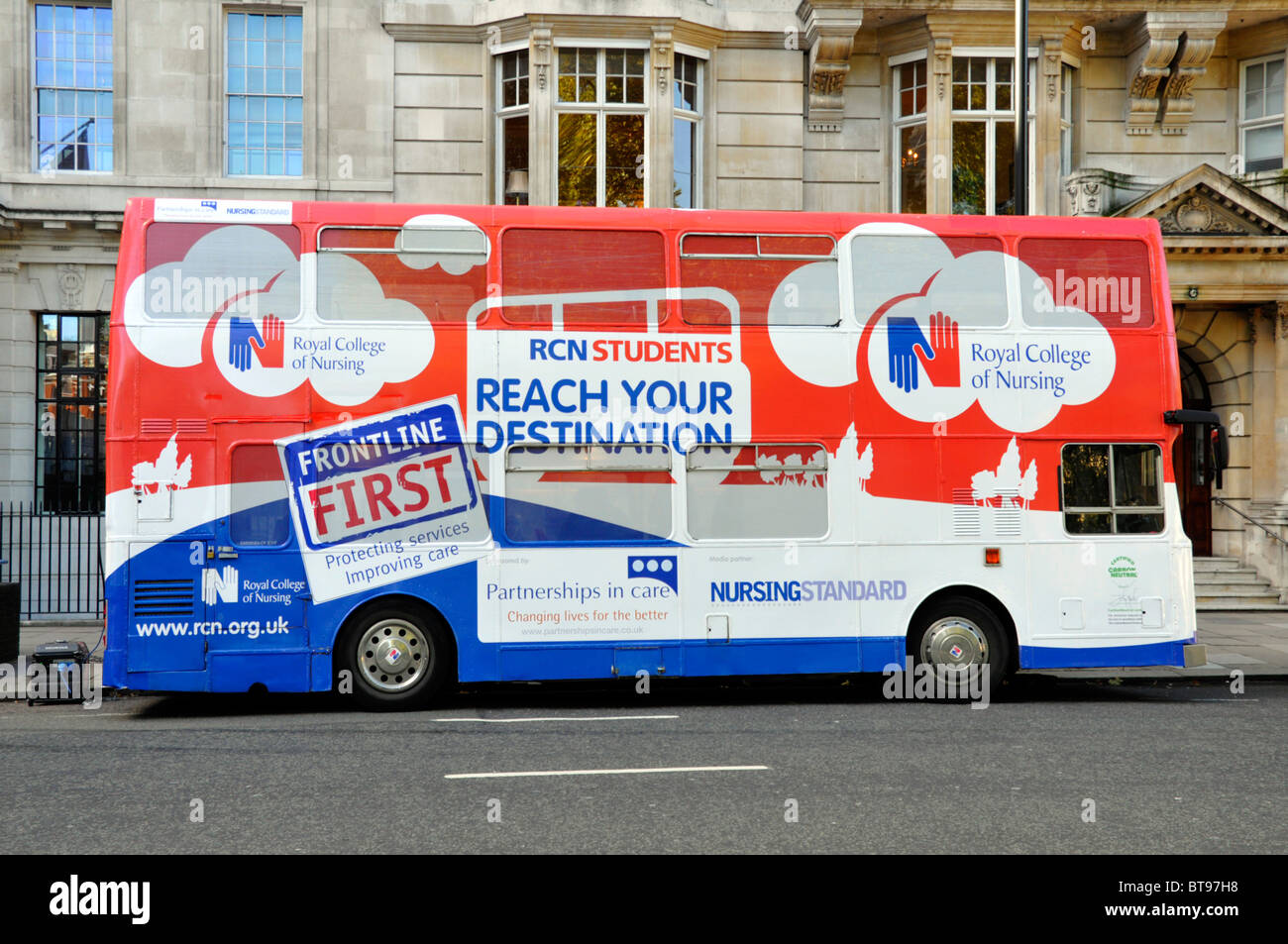 Bus advertising graphic design advert on side view of double decker bus for nurse job recruitment by the Royal College - Stock Image