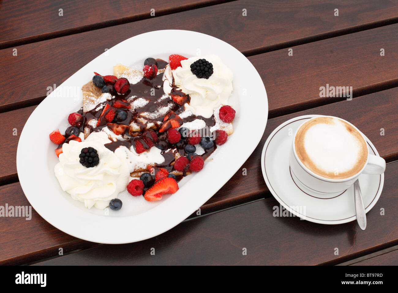 Pancakes with berries and cream, cappuccino, Burgenland, Austria, Europe - Stock Image