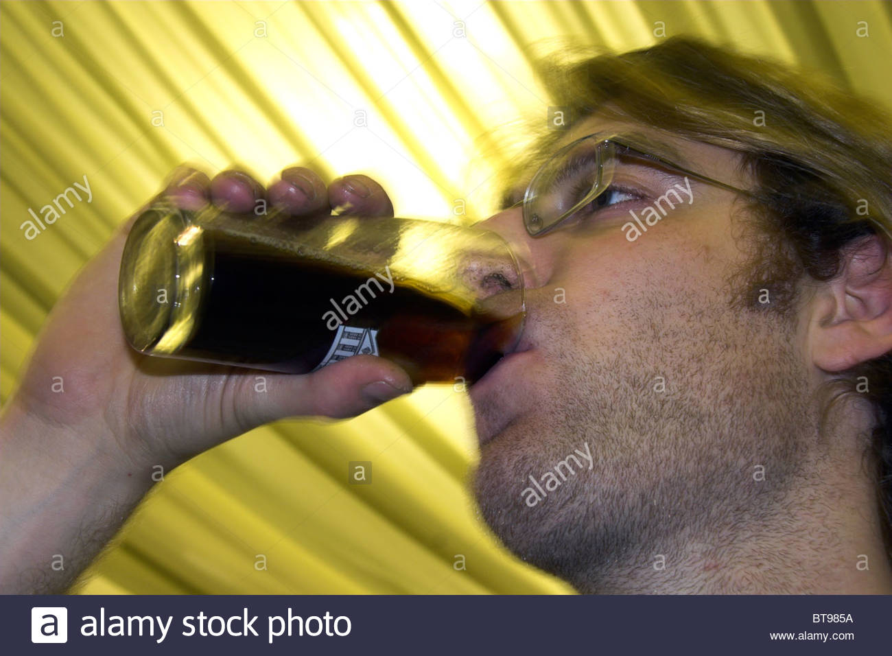 Man drinking a dark ale at the Bath Beer Festival 2010 in England, UK. Stock Photo