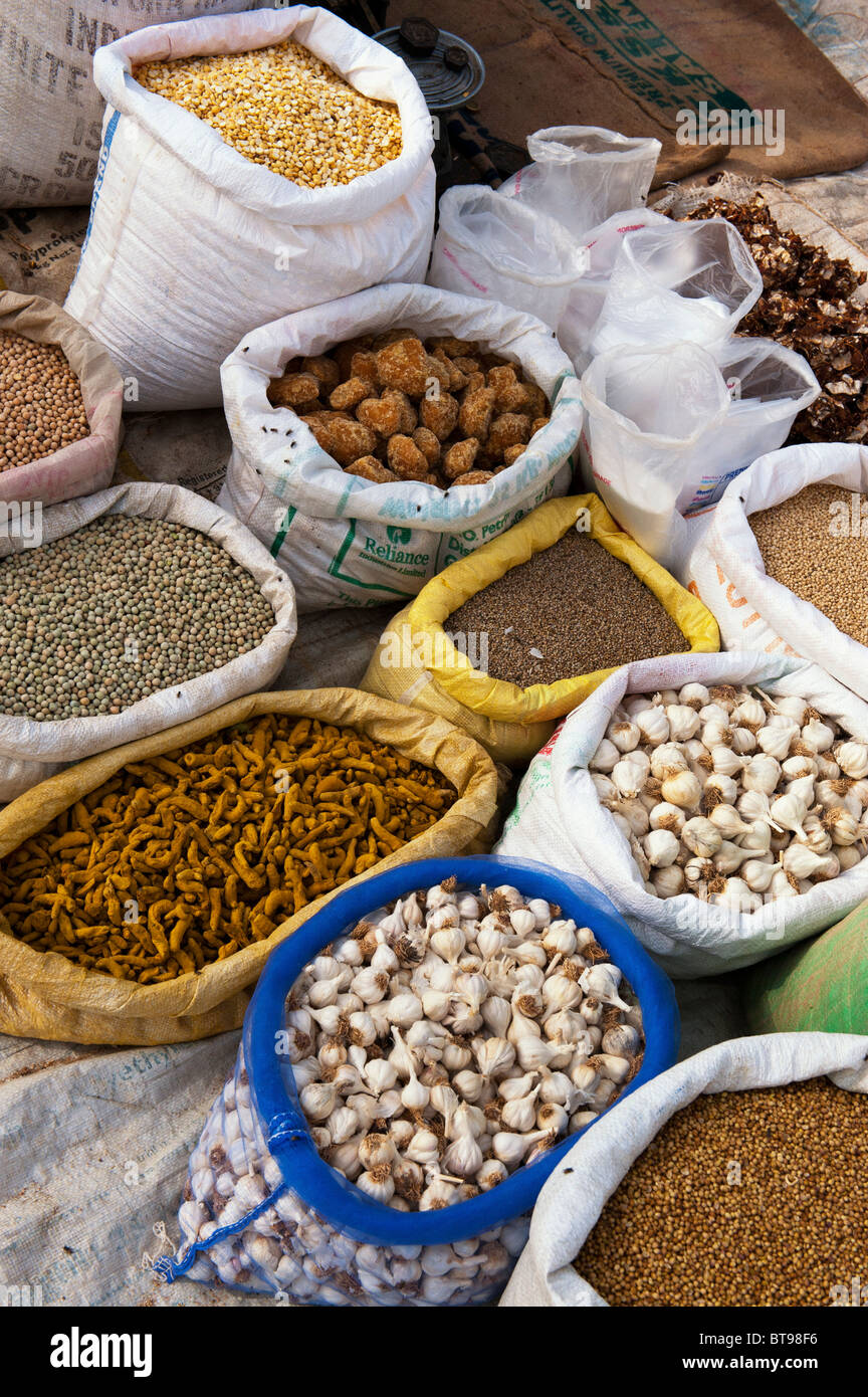 Indian market stall with sacks of indian spices and dried produce.  Puttaparthi, Andhra Pradesh, India - Stock Image