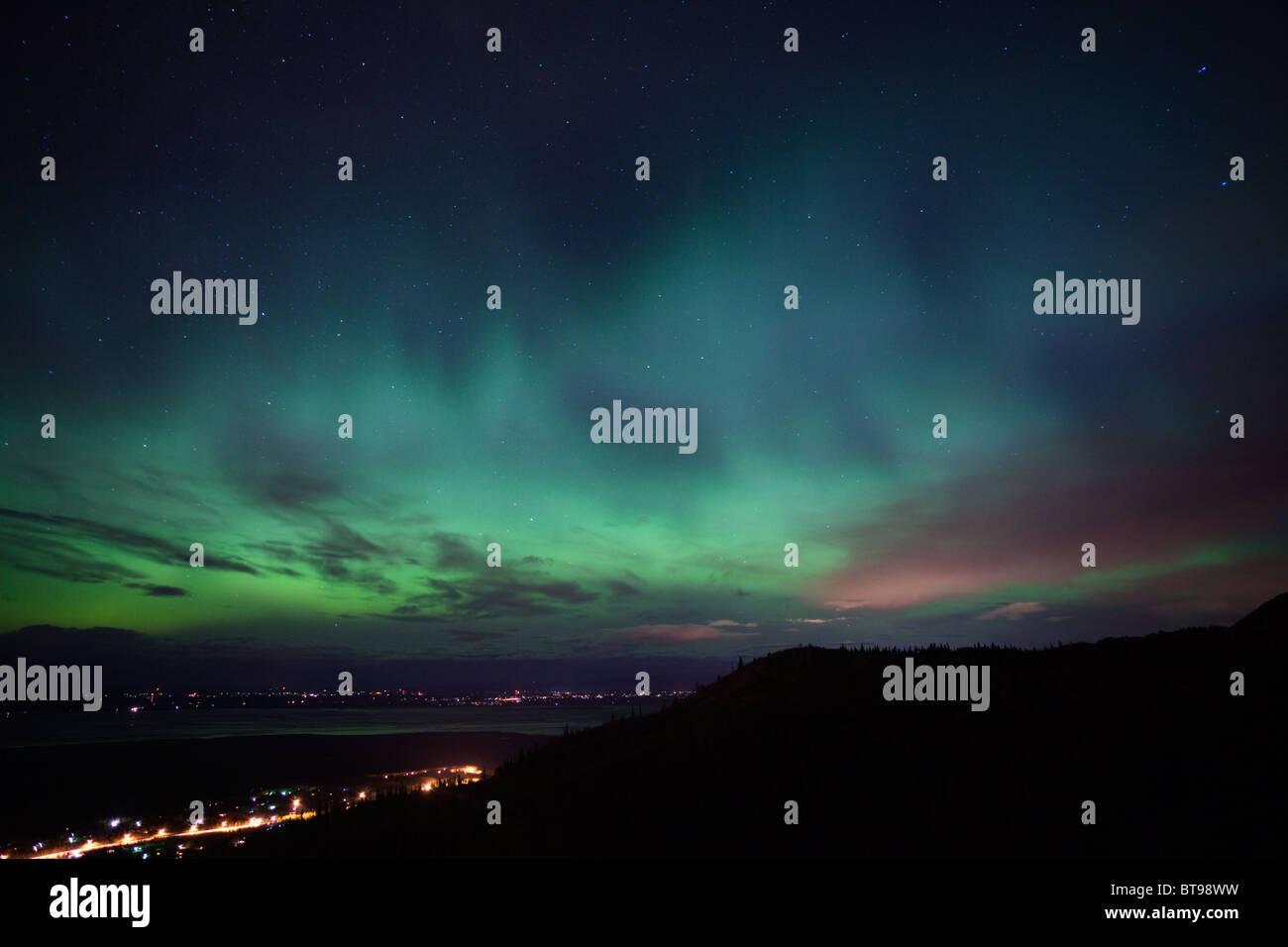 Aurora Borealis over towns in southcentral Alaska, Eagle River and Wasilla, AK - Stock Image