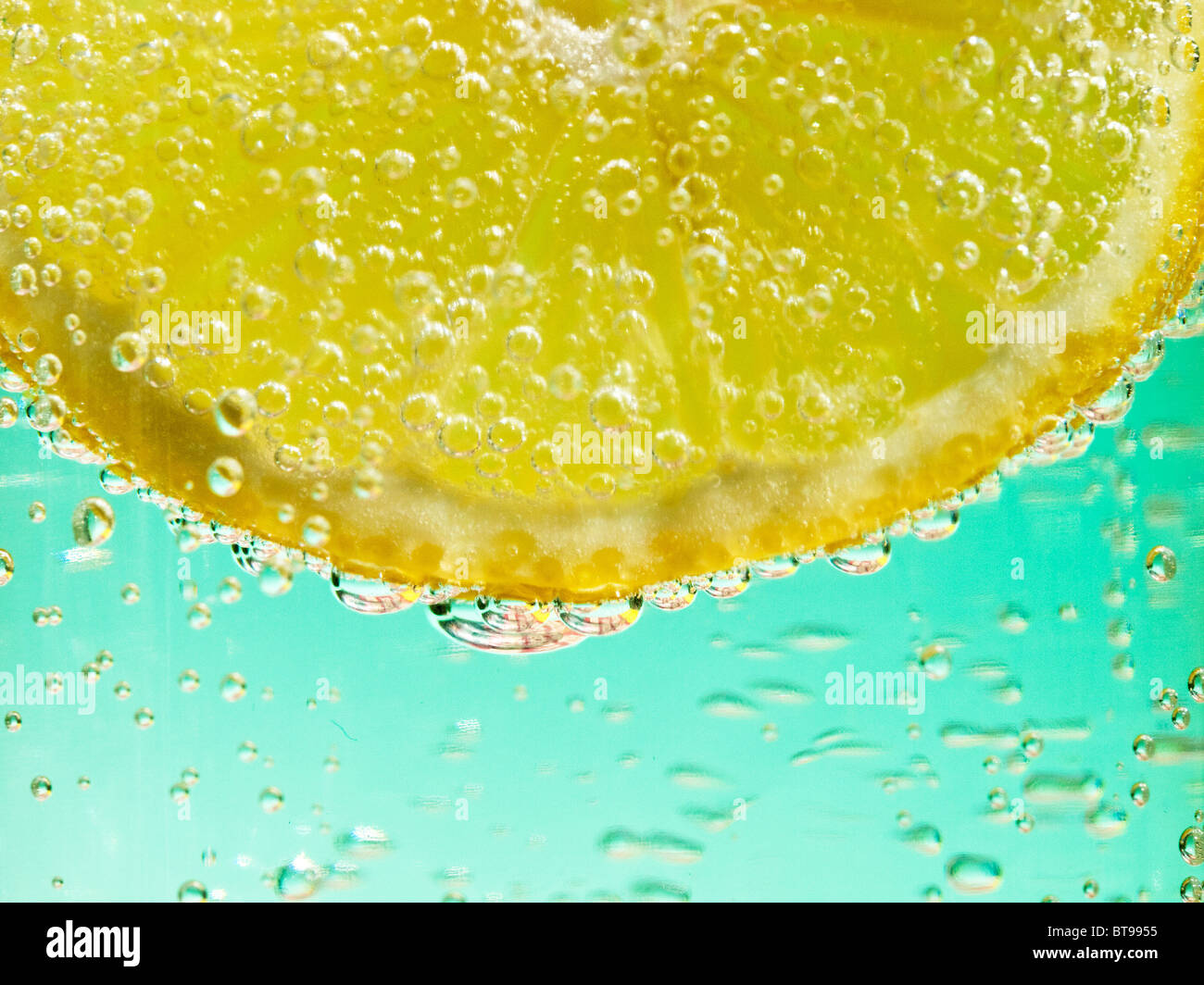 a close-up of a citron  in mineral water - Stock Image