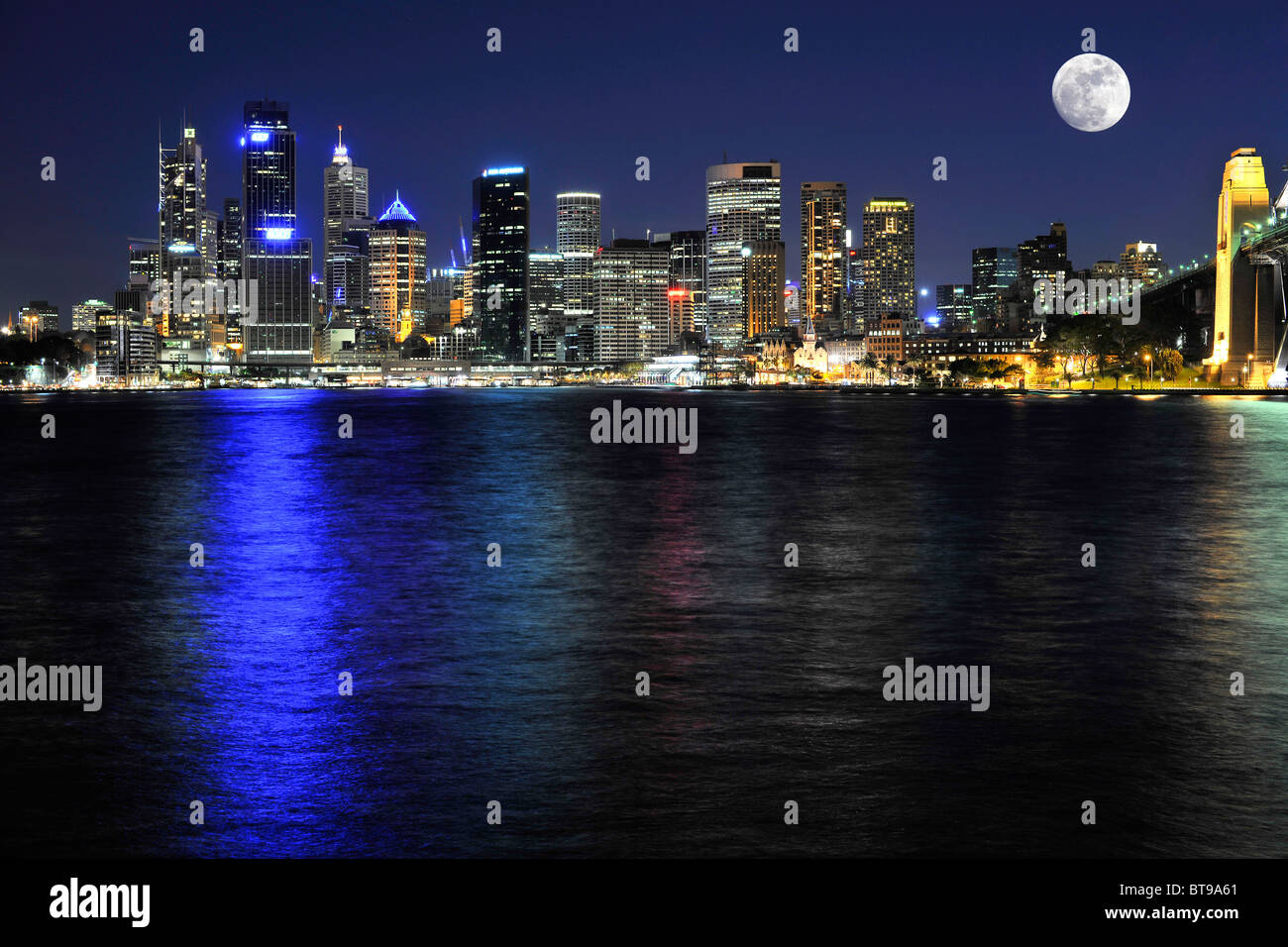 View of Sydney Cove with a full moon, Circular Quay, harbour, Sydney skyline, Central Business District, night, - Stock Image