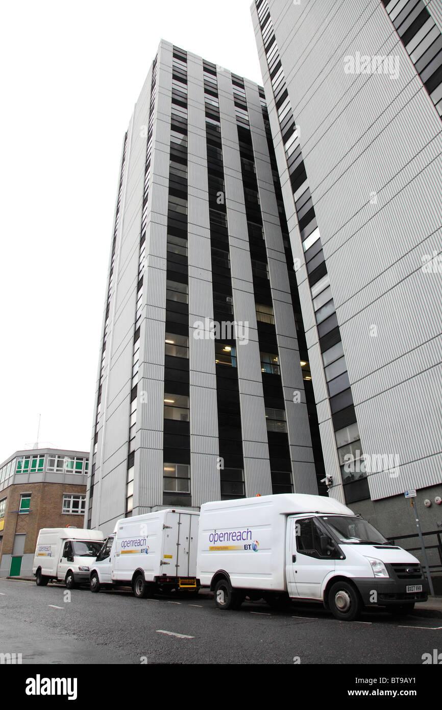 BT Openreach vans on a U.K. street. - Stock Image