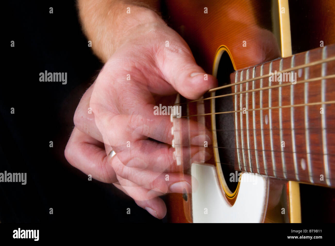 guitar strumming - Stock Image