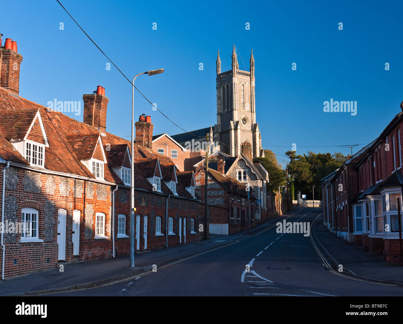 Row of pretty cottages and the Church of St Mary in Andover Hampshire - Stock Image