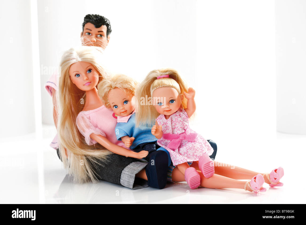 Symbolic image of a young family, children and parents, dolls - Stock Image