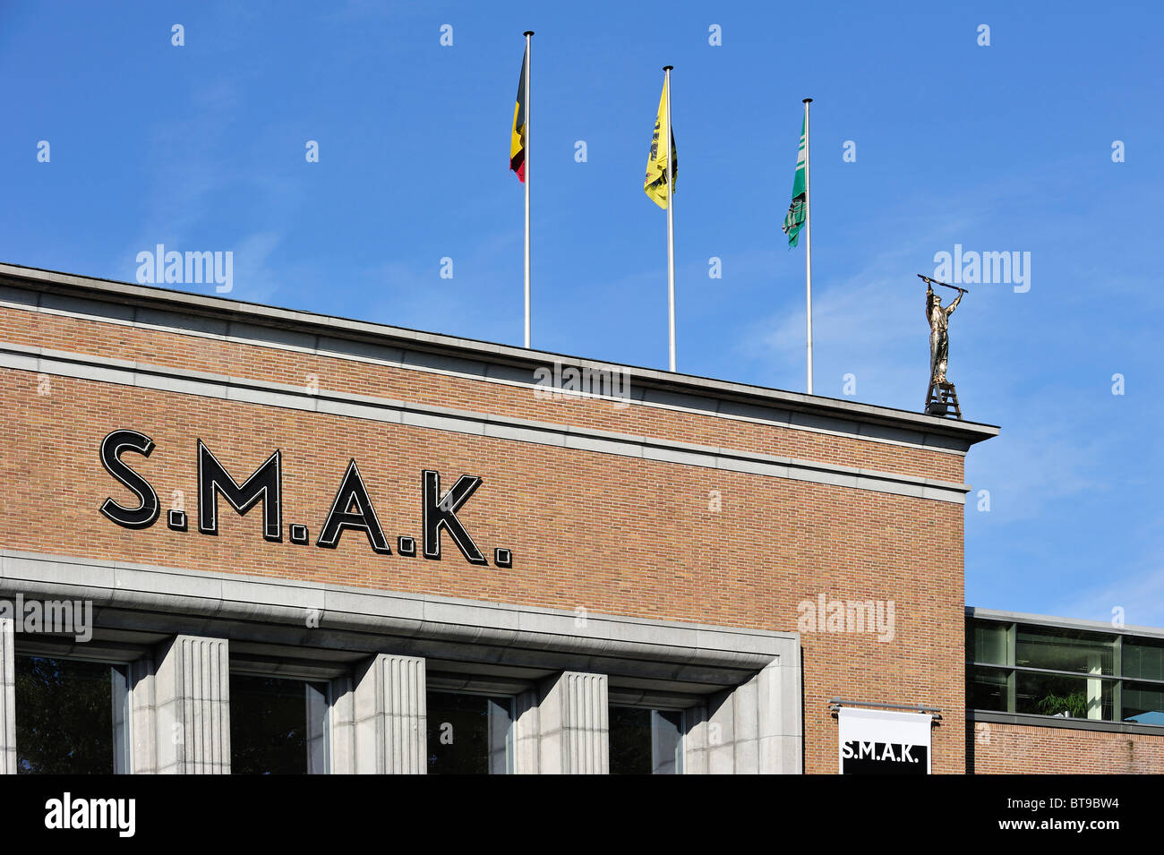 SMAK, the Municipal Museum of Contemporary Art at Ghent with sculpture of Jan Fabre on roof, Belgium - Stock Image