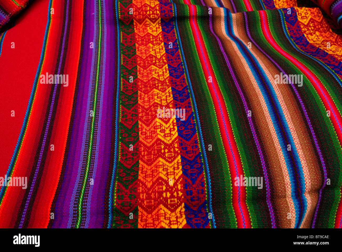 Peru, Sacred Valley, Pisaq, Sunday Market, bright colors in woven Peruvian fabric, many colors, stripes - Stock Image