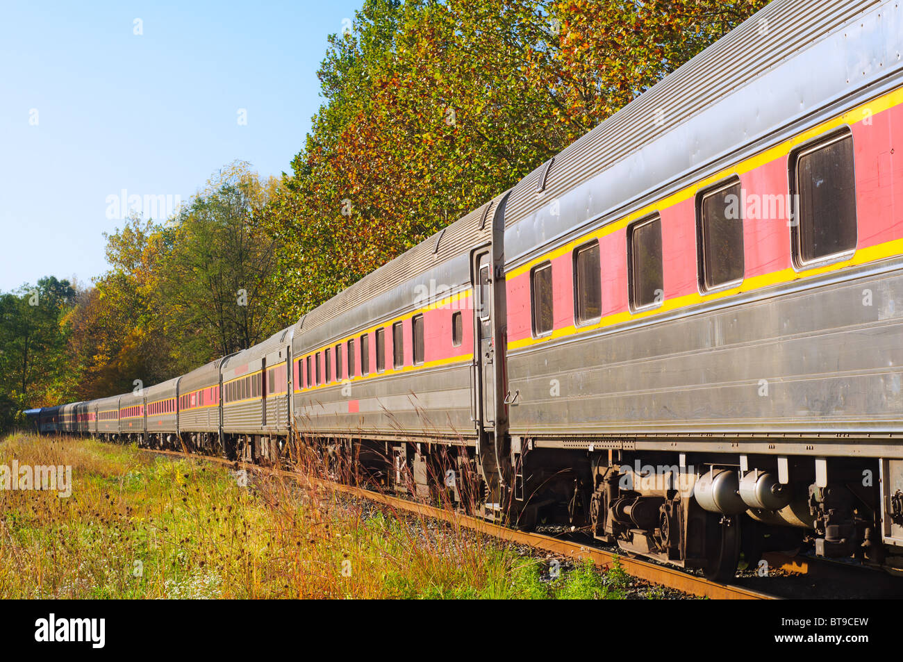 A vintage passenger excursion train in a rural setting. Stock Photo