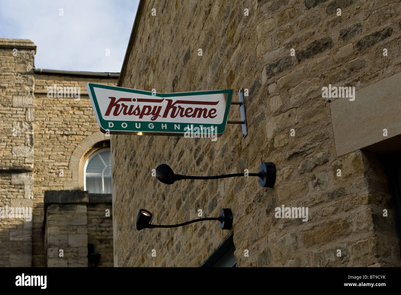 A Krispy Kreme doughnut stall in the Oxford Castle redevelopment in the centre of Oxford, UK - Stock Image