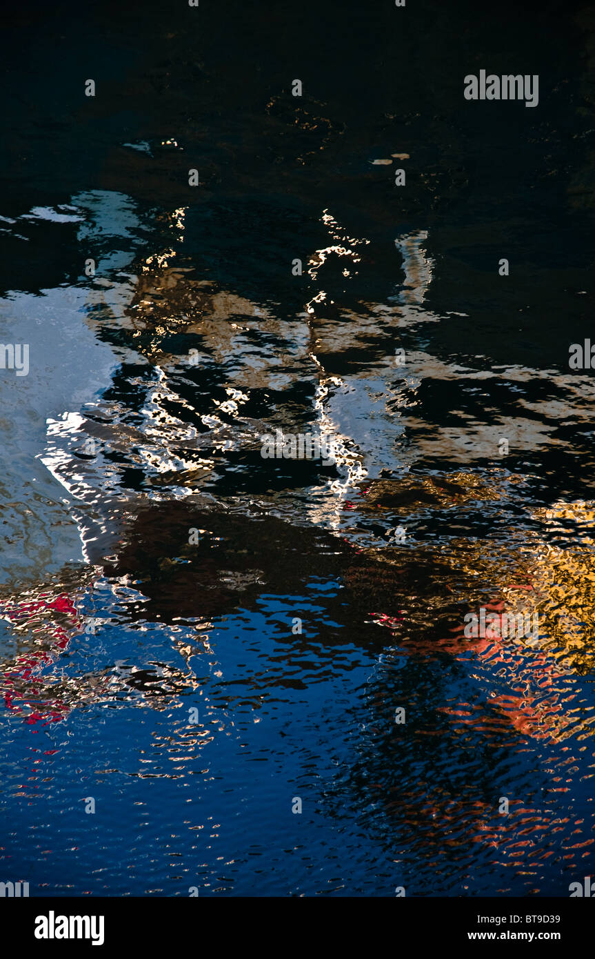 Metal surface reflections on water - Stock Image