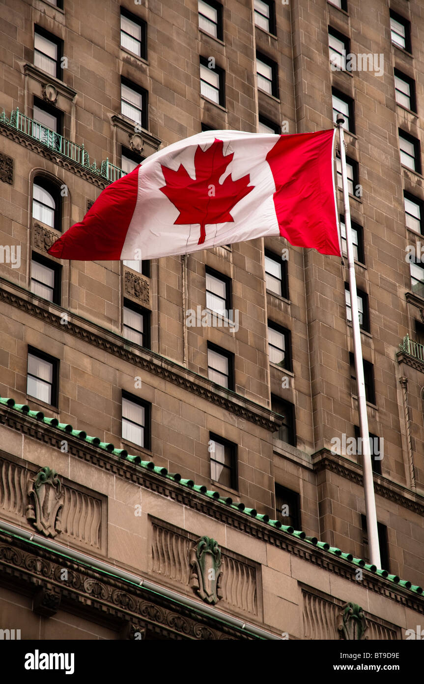 Canadian flag fluttering in the breeze Stock Photo