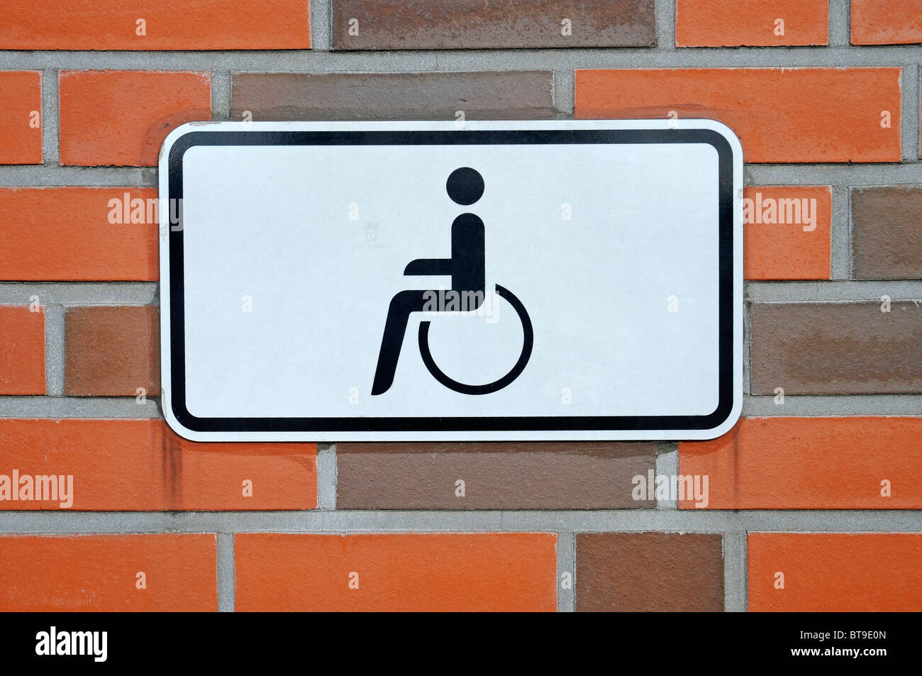 Accessibility for wheelchair users, pictogram, wall - Stock Image