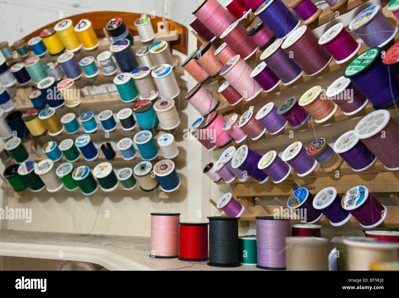 Broomfield, Colorado - Thread used for sewing and alterations at Lionheart Cleaners, a laundry and dry cleaning - Stock Image