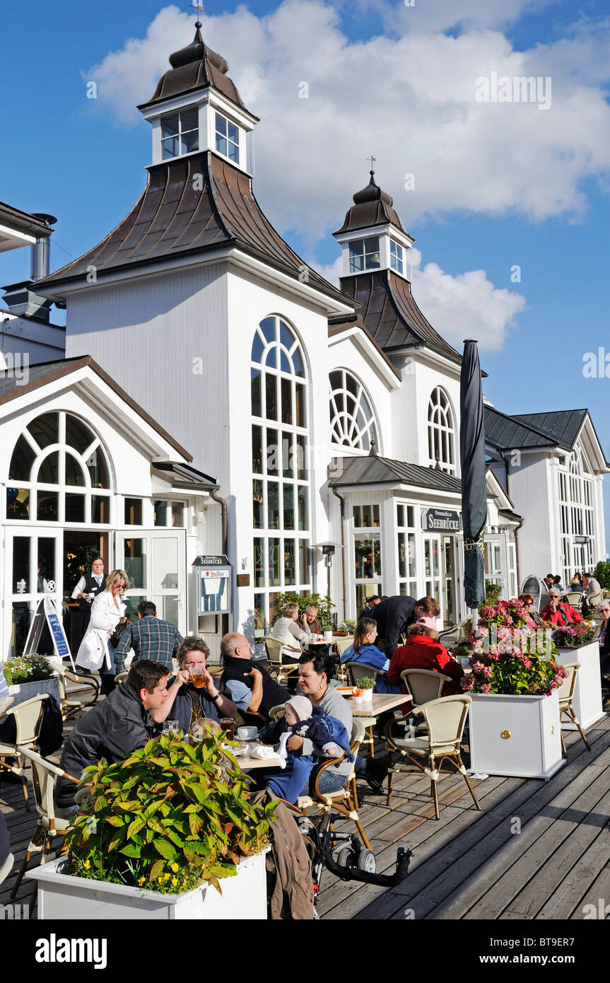 Guests at the cafe on the pier in the Baltic resort Sellin, Ruegen Island, Mecklenburg-Western Pomerania, Germany, - Stock Image