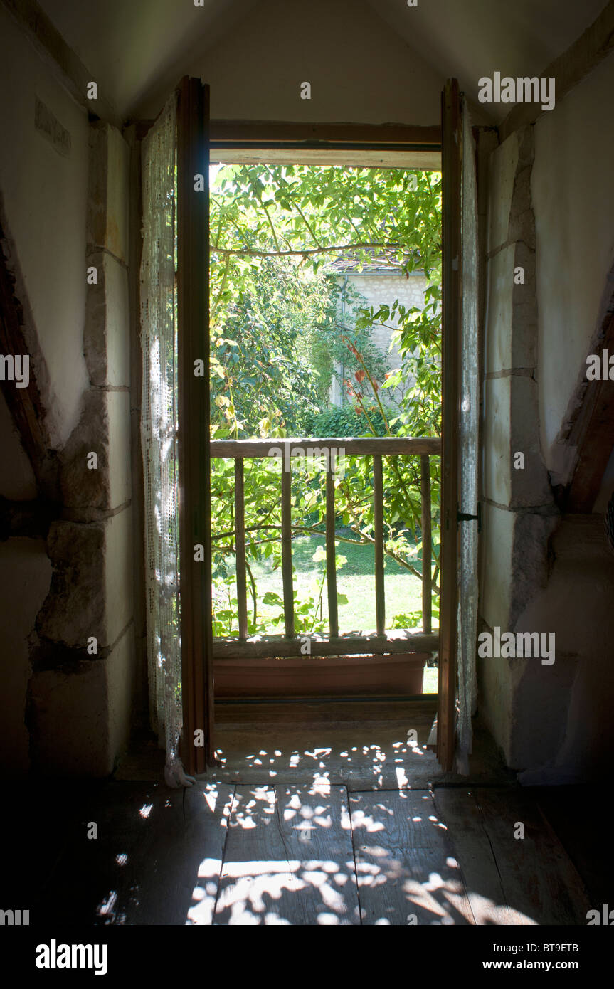 An open door looking out over a garden - Stock Image