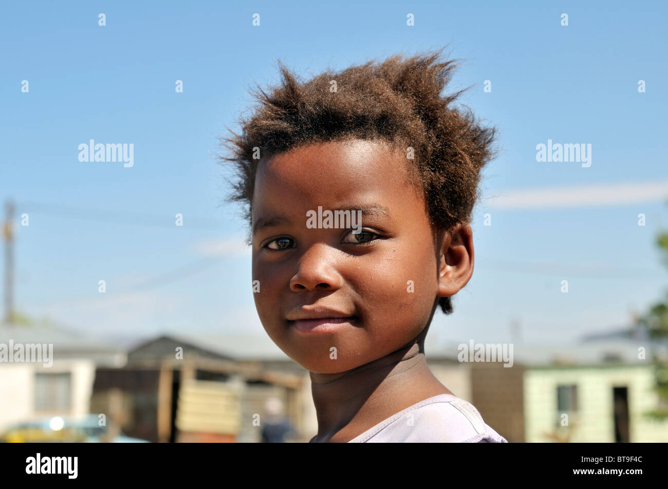 Portrait of a girl with confident gaze, slum, township, Queenstown, Eastern Cape, South Africa, Africa - Stock Image