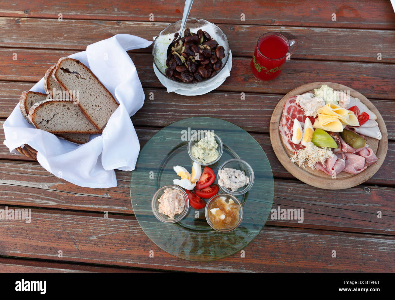 Hearty snack, bread and a plate with a variety of spreads, Brettljause, a plate with cold cuts, Styrian scarlet - Stock Image
