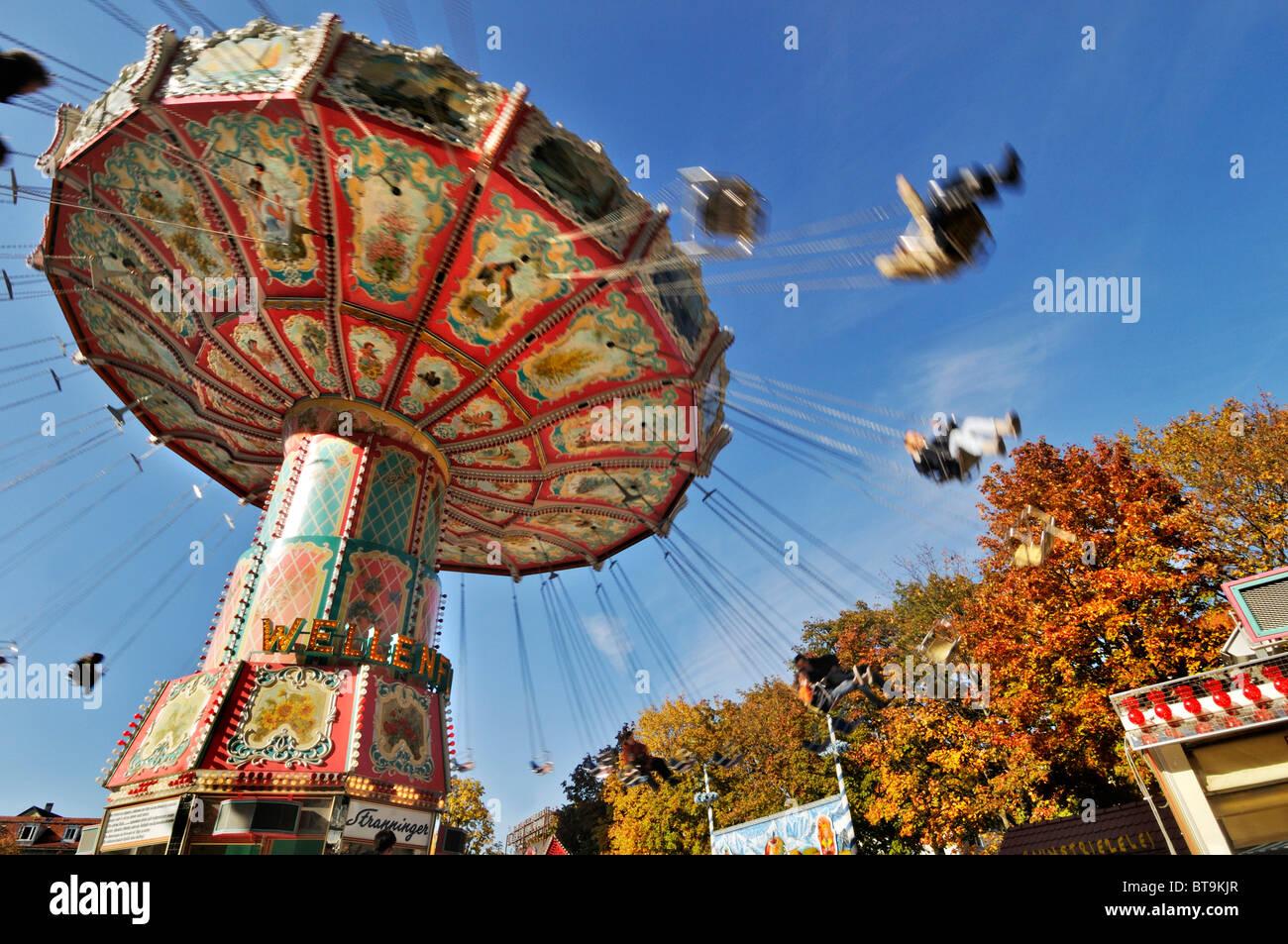 Chair-o-planes or swing carousel, Auer Dult fair, Munich, Bavaria Stock Photo