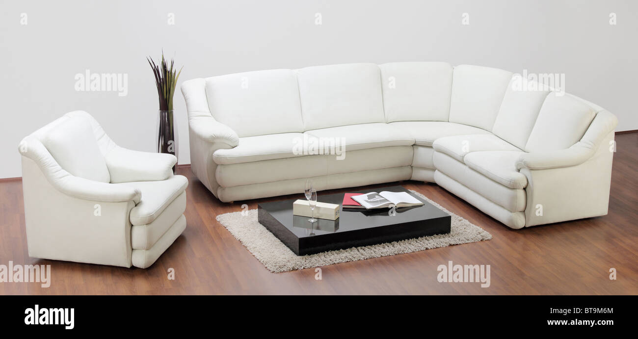 A studio shot of a white furniture, sofa and chair - Stock Image