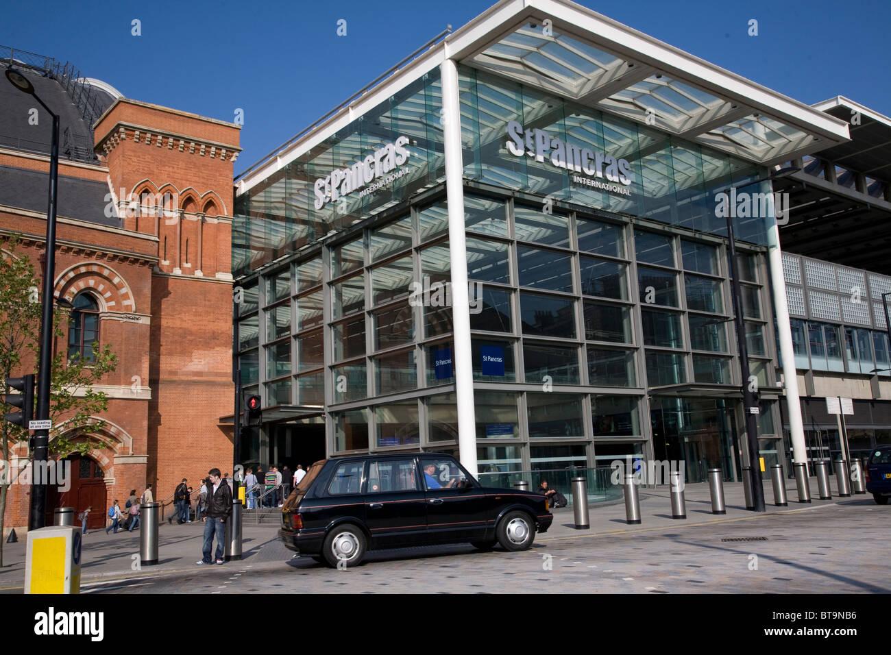 Black taxi cab waiting outside Kings Cross St Pancras station. London. England Stock Photo
