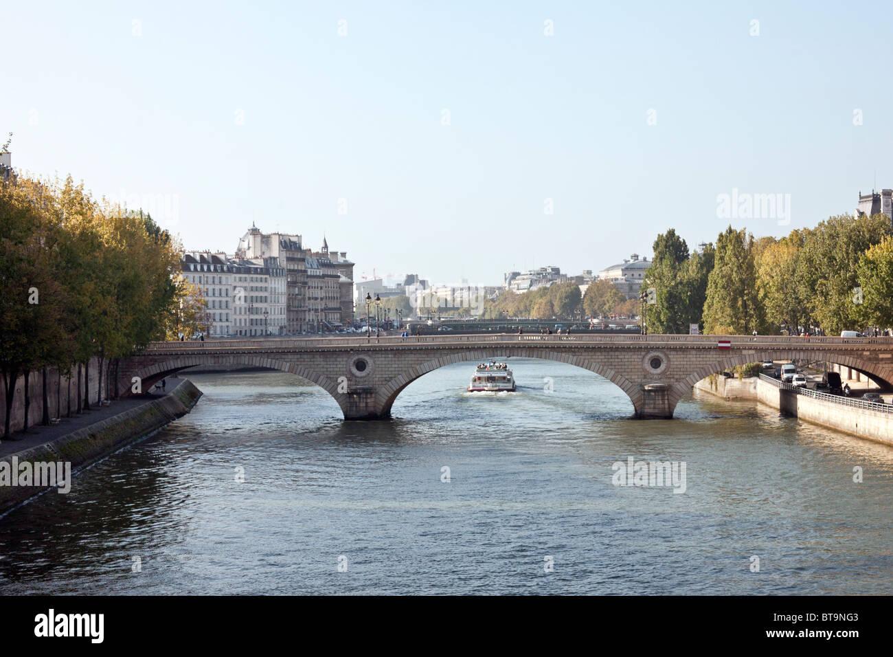 view of graceful arches Pont Louis Phillipe & Ile de la Cite beyond, with Quai de Bourbon in left foreground - Stock Image