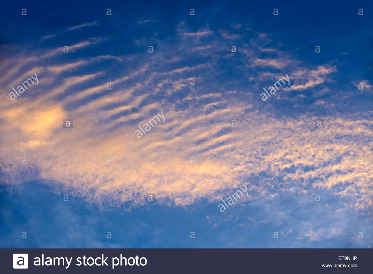 Cirrus uncinus at sunrise over the Cylades Island of Ios - Stock Image