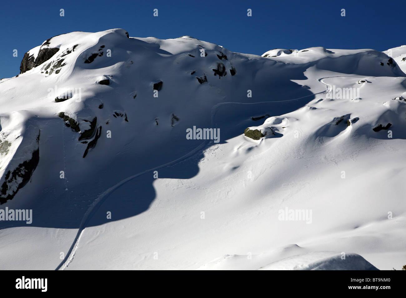 off piste snowboard trail line in powder snow in serra da estrela