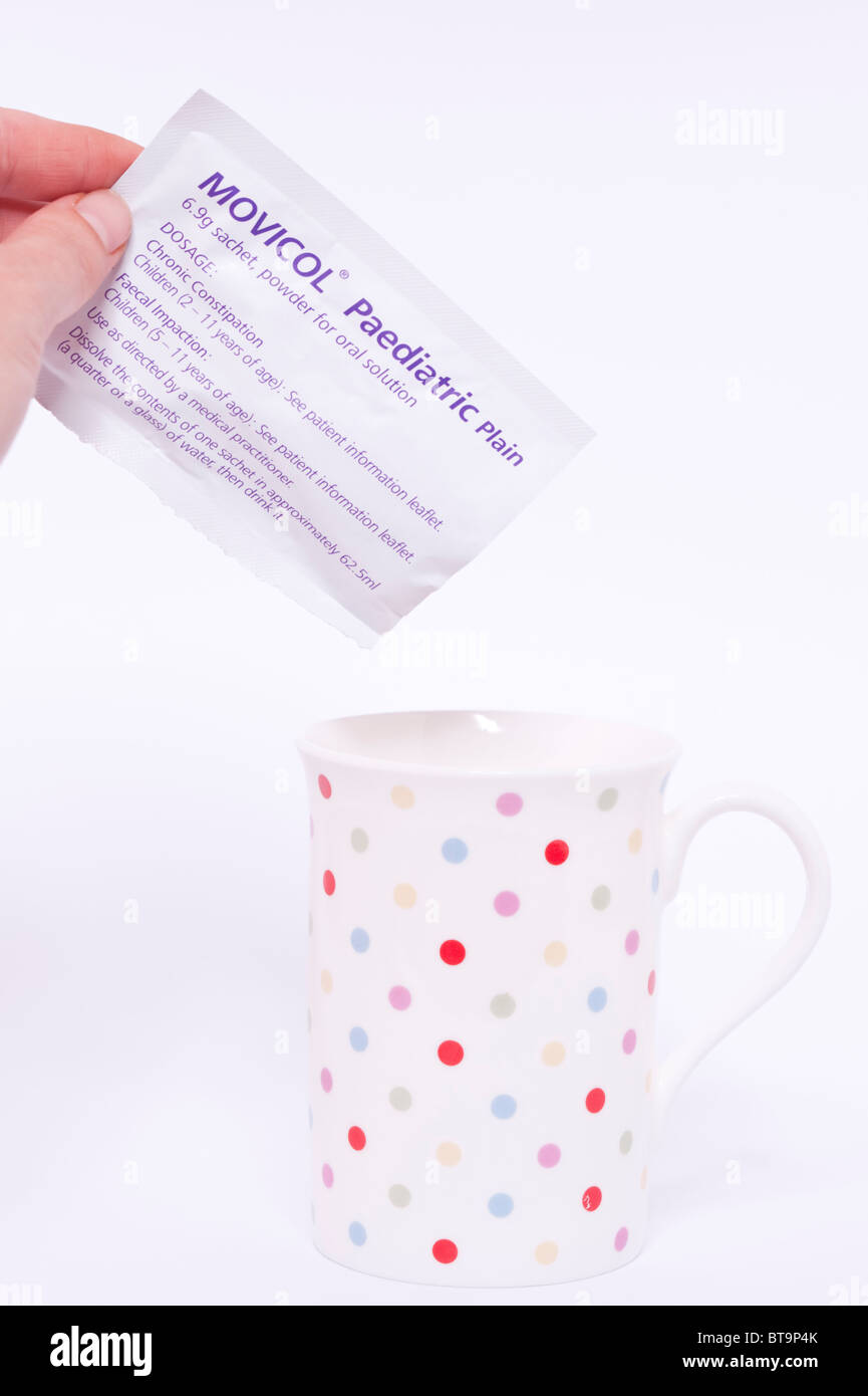 Pouring a sachet of Movicol oral solution for chronic