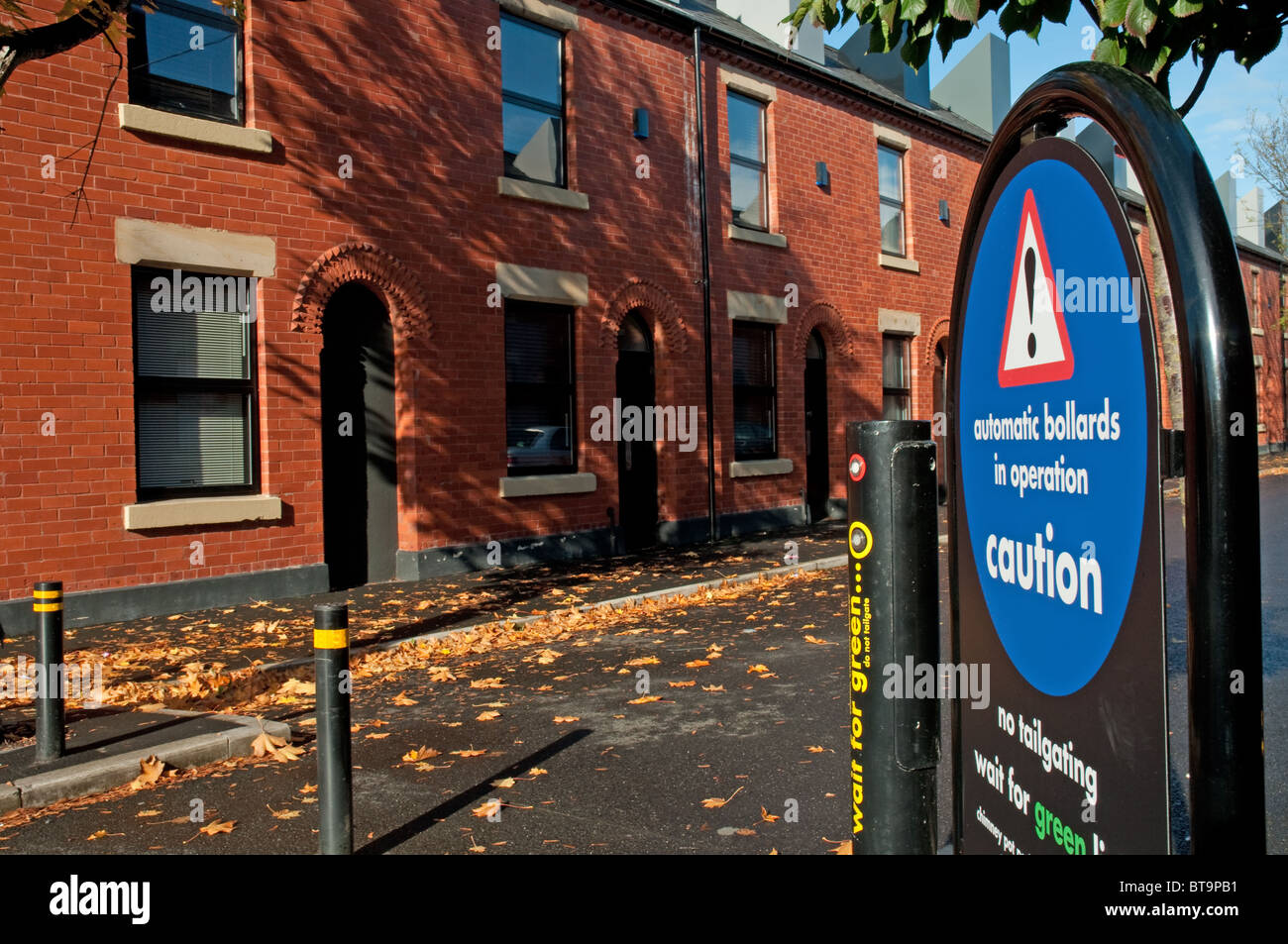 Automatic bollard access to resident parking at Chimney Pot Park,Salford Greater Manchester - Stock Image