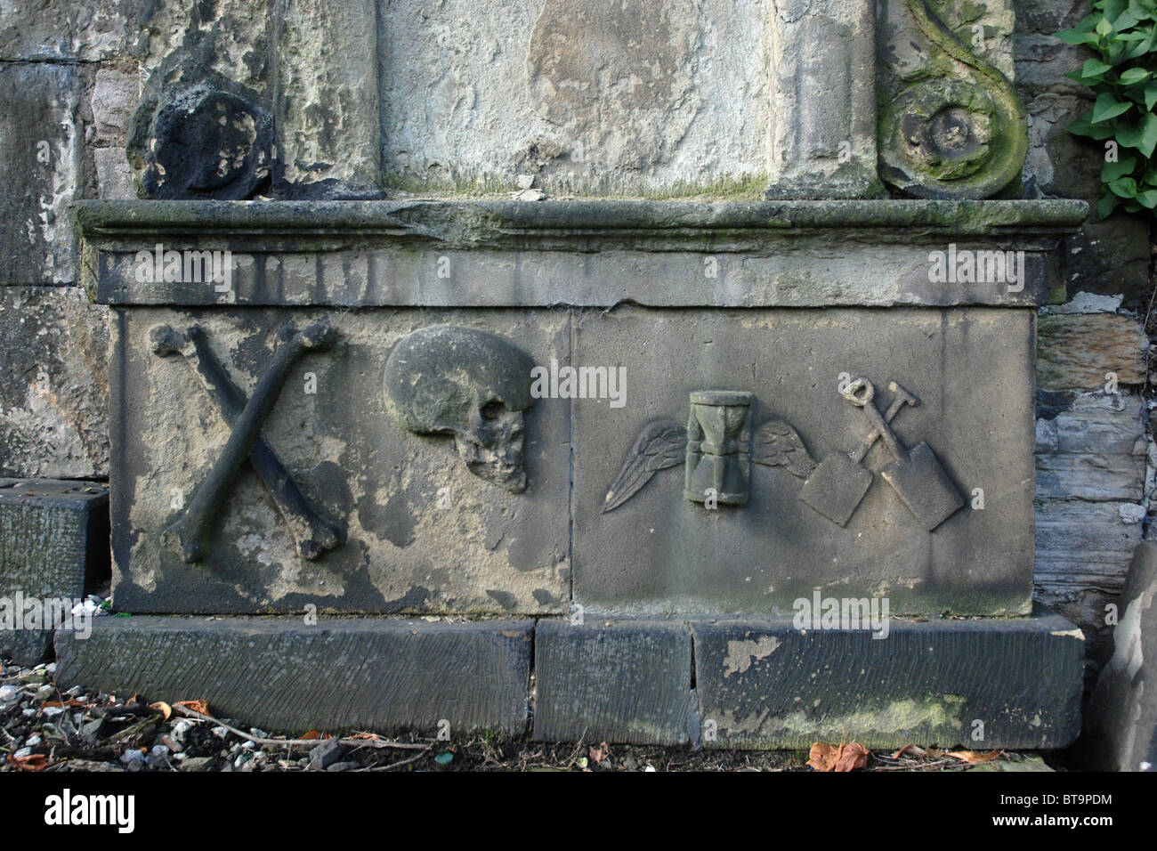Weathered memorial with various symbols in Old Calton Burial Ground, Edinburgh, Scotland, UK - Stock Image