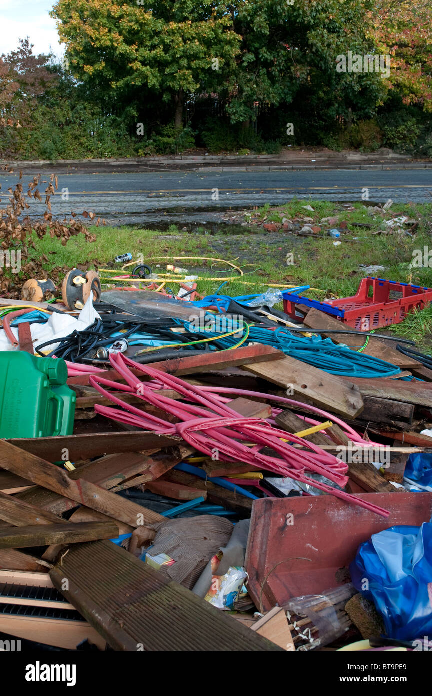 Fly tipping in Manchester.Rubbish illegally dumped.Old Trafford Manchester - Stock Image