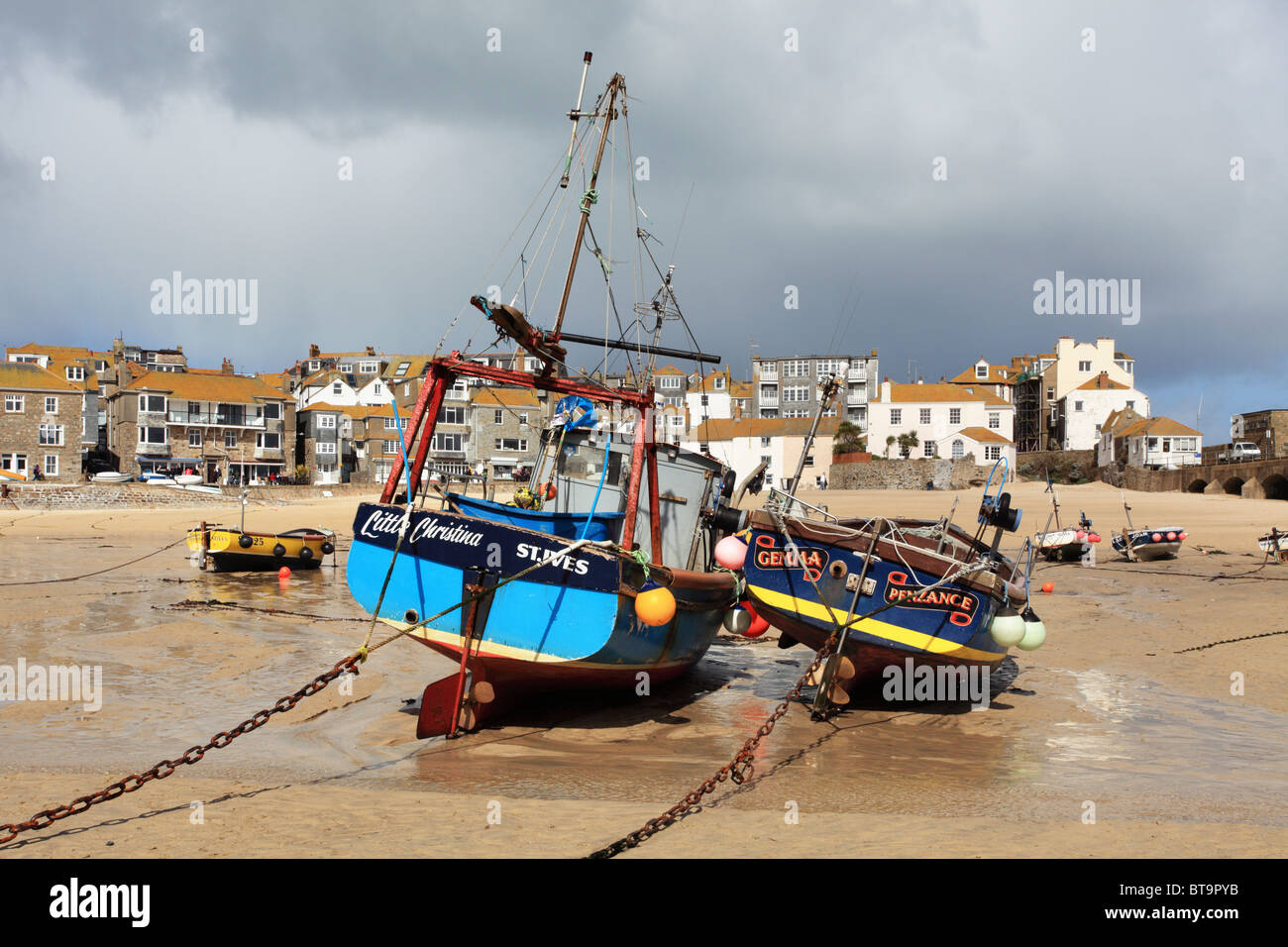 Boats in St Ives harbour captured at low tide Stock Photo