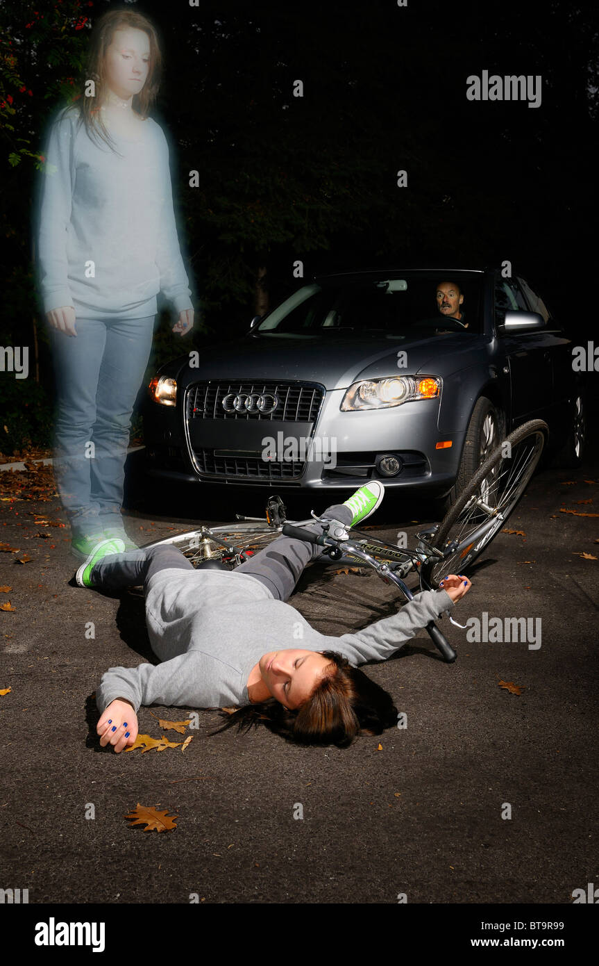 Shocked man in car stopped at a fallen dead young female bicyclist on the road with her ghost spirit watching - Stock Image